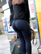 Gals with juicy rump in dark leggings